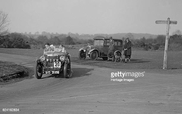 MG M type and official's Singer saloon at the JCC HalfDay Trial 1930 Artist Bill BrunellCentre MG M Type 1930 847 cc Vehicle Reg No UD3166 Event...