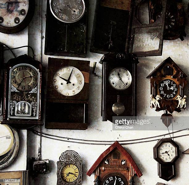 Types of clocks hanging on wall