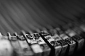 A macro black & white photogrpah of the typebars from an antique Underwood No. 4 typewriter.