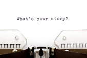 Concept image with What's Your Story printed on an old typewriter.