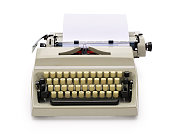 Typewriter from the 70s with blank paper for text, isolated on white background. Contains clipping path.