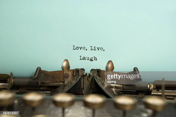 Typewriter with text love live laugh
