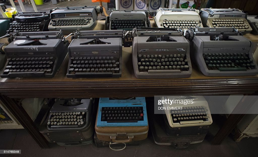 Typewriters are displayed as part of former New York sanitation worker Nelson Molina's Treasure in the Trash gallery on February 27, 2016 in New York. His exhibit, on the second floor of an East Harlem sanitation garage, was compiled during his 33 years on the job collecting trash. / AFP / Don EMMERT