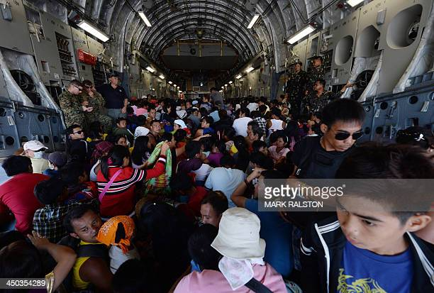 Typhoon victims are loaded onto a US Air Force C17 Cargo plane before being evacuated to Manila at Tacloban Airport in the aftermath of Typhoon...