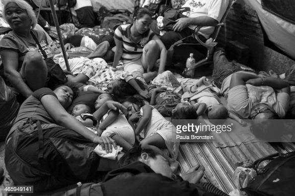 Typhoon victims are packed into a tent after typhoon Haiyan in Tacloban November 13 2013 The Philippines has been host to a number of natural...