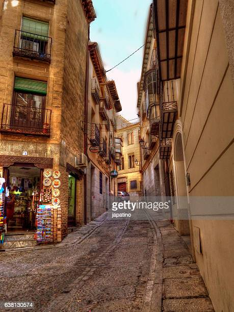 Typical and narrow shopping street of the old town of Toledo