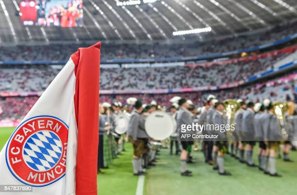 A typical Bavarian brass band plays prior to the German First division Bundesliga football match FC Bayern Munich v Mainz 05 in Munich southern...
