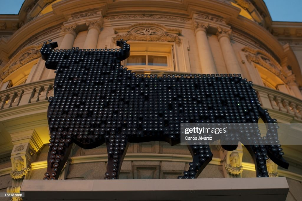 A typical bull Osborne, designer by artist Willie Marquez to Swarosky is displayed in front of the building of Casa de America on July 9, 2013 in Madrid, Spain.