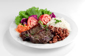 This is the most common dish in Brazil, rice, beans, steak and tomato salad with lettuce.This is the most common dish in Brazil, rice, beans, steak and tomato salad with lettuce.