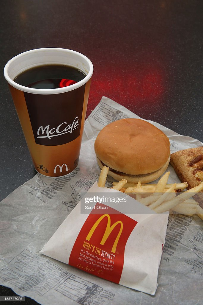 Typical Dollar Menu items are shown from a McDonald's restaurant on October 24, 2013 in Des Plaines, Illinois. McDonald's has announced it will make changes to its low-priced Dollar Menu, which includes items like coffee, small fries, hamburgers and apple pies. The new menu, dubbed the Dollar Menu and More, will offer some higher priced options such as the grilled Onion Cheddar Burger and a McChicken sandwich.