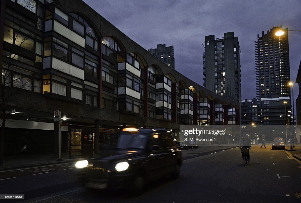 CONTENT] A typical evening scene in Clerkenwell, London. The Barbican Towers are in the backdrop. A London taxi drives past. A cyclist is on his bike. The post-war Brutalist architecture is on display. Taken early evening on April 30, 2012.
