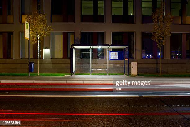 Typical german bus stop at night, traffic on street