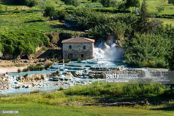 Typical green Tuscany landscape with hills olive trees grain fields and the hot springs of Saturnia Therme