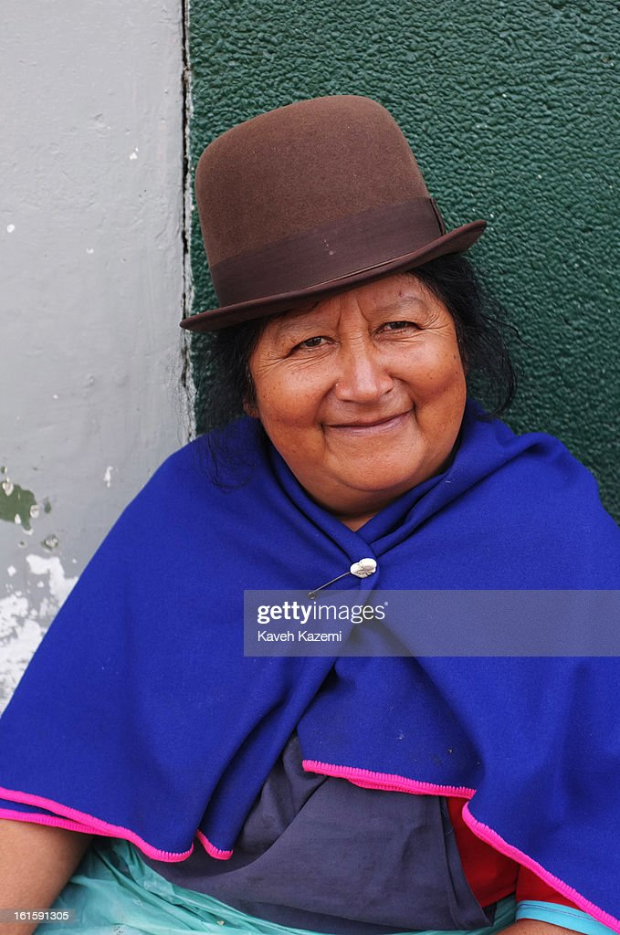 A typical Guambiano Indian woman dressed in traditional costumes selling fresh vegetables in Barrio Bolivar day market on January 23, 2013 in Popayan, Colombia.