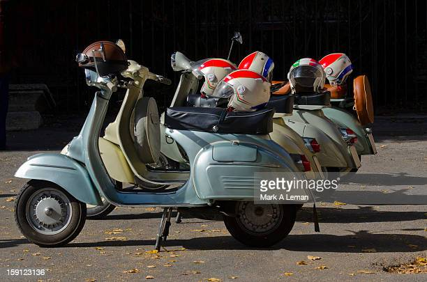 Typical Italian scooters and patriotic helmets
