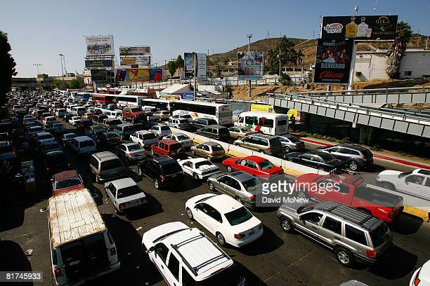 Typical massive lines of cars wait daily to cross into the US from Mexico at the San Ysidro border crossing the world's busiest on June 27 2008 in...