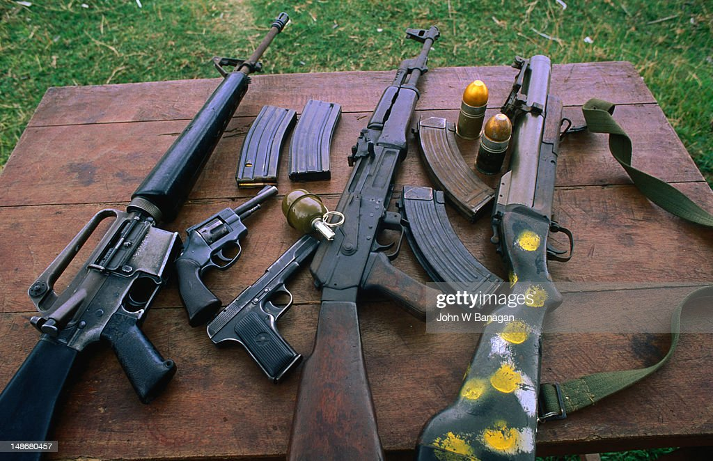 Typical military hardware still in circulation throughout Cambodia. These guns are available for hire at a local firing range. : Stock Photo
