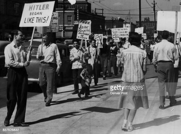 Typical of the signs displayed by pickets parading before federal court Saturday is the one above reading ' Hitler Began Like This' The sign refers...