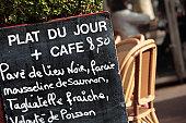Typical Paris restaurant menu board outdoors