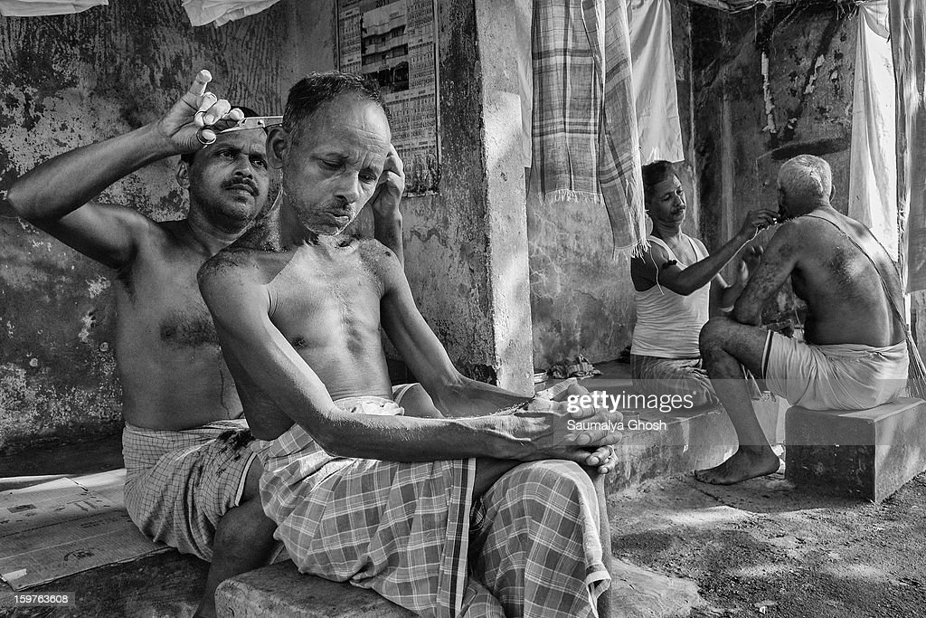 CONTENT] A typical roadside salon in Kolkata. One man is getting a haircut and another person is getting a shave.