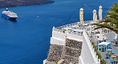 VIew of typical Santorini island rooftop terraces that offer fabulous views of the blue Aegean sea and smaller islands around