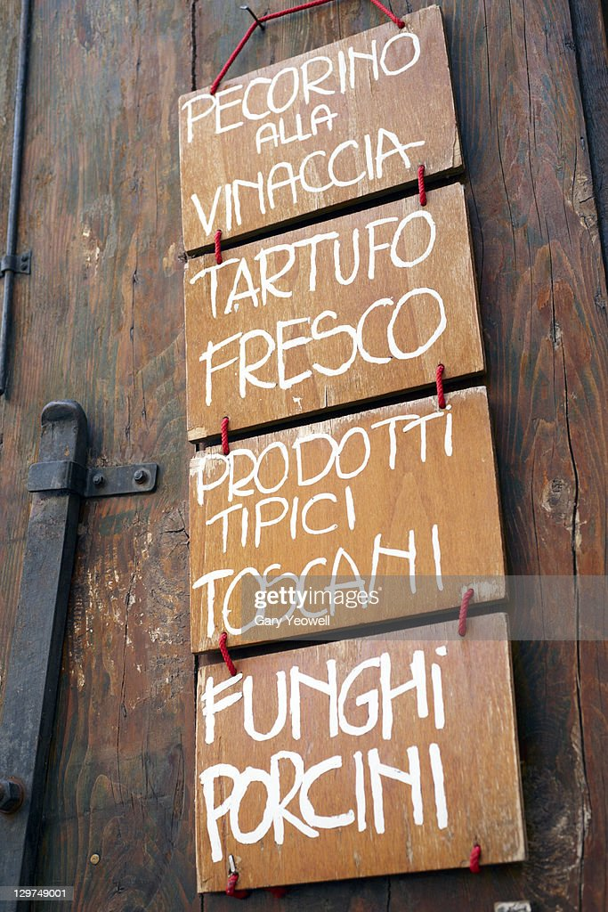 Typical sign outside traditional food shop : Stock Photo