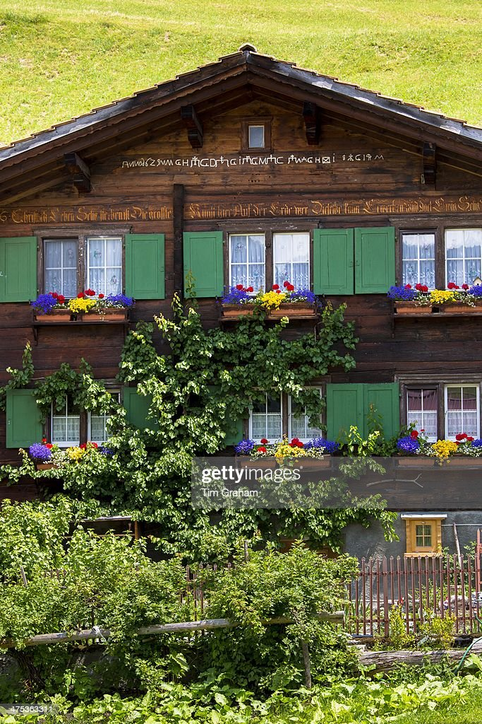 Typical swiss wooden alpine chalet style house with for Alpine style homes