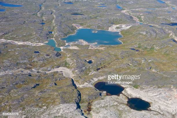A typical view of the Greenlandic landscape photographed a couple of hundred meters above the ground The land is clearly marked and shaped by the ice...