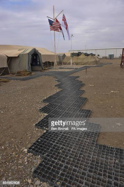 A typical walkway made from interlocking plastic squares of matting in Camp Bastion Helmand Province Afghanistan