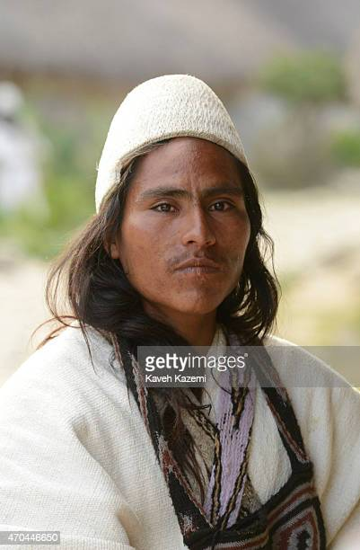 A typically dressed Arhuaco man holds a Poporo seen inside the walled village on January 23 2015 Nabusimake Colombia Poporo is a gourd containing...