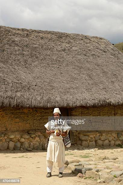 A typically dressed Arhuaco man seen inside the walled village on January 23 2015 in Nabusimake Colombia The man holds a Poporo Poporo is a gourd...