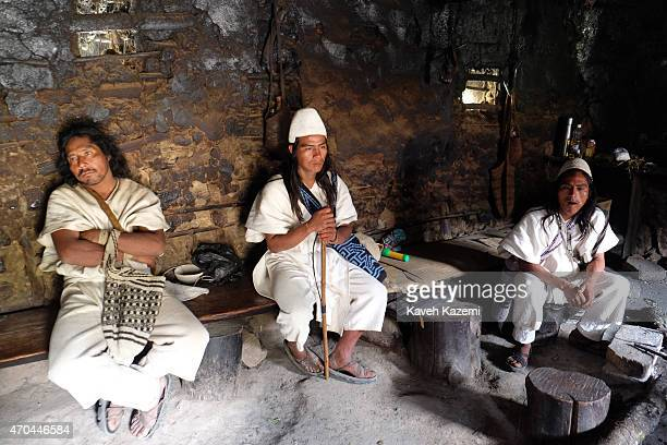 Typically dressed Arhuaco men seen inside a hut in the walled village on January 23 2015 in Nabusimake Colombia The Arhuacos appear in white serapes...