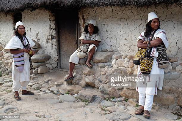 Typically dressed Arhuaco men seen standing outside a hut in the walled village on January 23 2015 in Nabusimake Colombia The Arhuacos appear in...