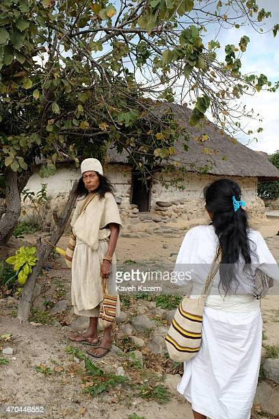 A typically dressed Arhuaco people seen inside the walled village on January 23 2015 Nabusimake Colombia Nabusimake is the spiritual center of the...