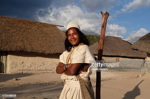 A typically dressed young Arhuaco man seen inside the walled village on January 23 2015 in Nabusimake Colombia The Arhuaco men appear in white...