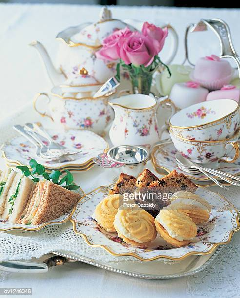 Typically English Cakes, Sandwiches and Tea on a Tray