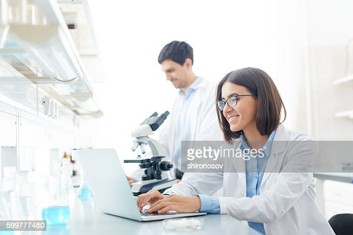 Typing in lab : Stock-Foto