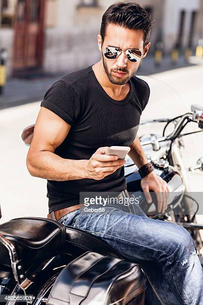 Typing message while sitting on motorbike
