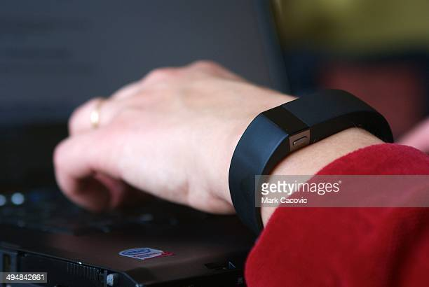 Typing on laptop wearing a Fitbit