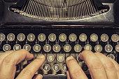 typing on antique typewriter