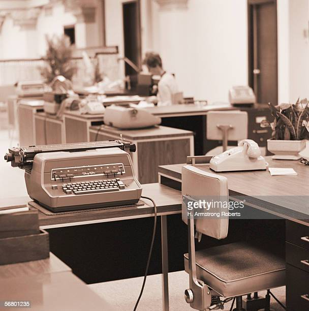 Typing pool workstation desk chair electric typewriter and telephone