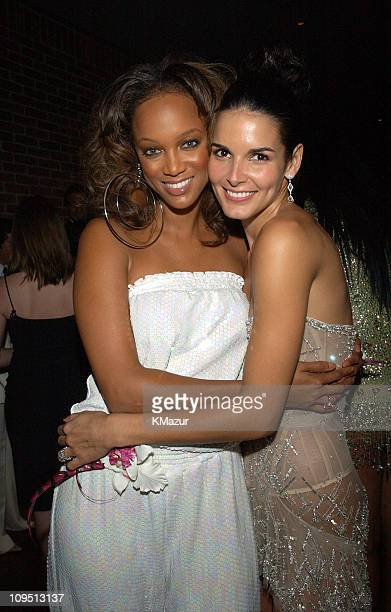 Tyra Banks and Angie Harmon during 2002 VH1 Vogue Fashion Awards AfterParty at Hudson Cafeteria at Hudson Hotel in New York New York United States