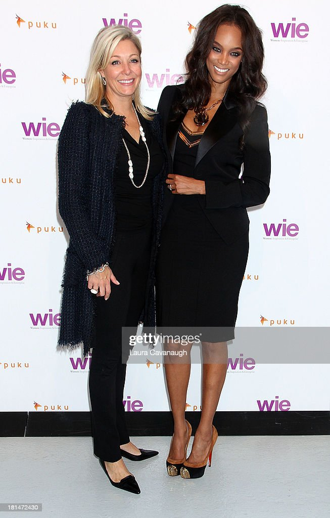 Tyra Banks and Nadja Swarovski attend day 2 of the 4th Annual WIE Symposium at Center 548 on September 21, 2013 in New York City.