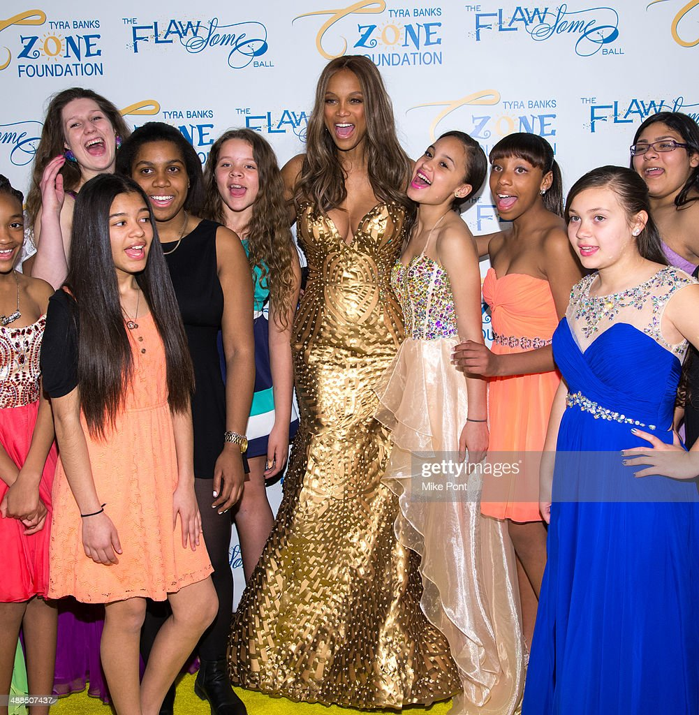 <a gi-track='captionPersonalityLinkClicked' href=/galleries/search?phrase=Tyra+Banks&family=editorial&specificpeople=202216 ng-click='$event.stopPropagation()'>Tyra Banks</a> (C) and the girls of the <a gi-track='captionPersonalityLinkClicked' href=/galleries/search?phrase=Tyra+Banks&family=editorial&specificpeople=202216 ng-click='$event.stopPropagation()'>Tyra Banks</a> TZONE attend <a gi-track='captionPersonalityLinkClicked' href=/galleries/search?phrase=Tyra+Banks&family=editorial&specificpeople=202216 ng-click='$event.stopPropagation()'>Tyra Banks</a>' Flawsome Ball 2014 at Cipriani Wall Street on May 6, 2014 in New York City.