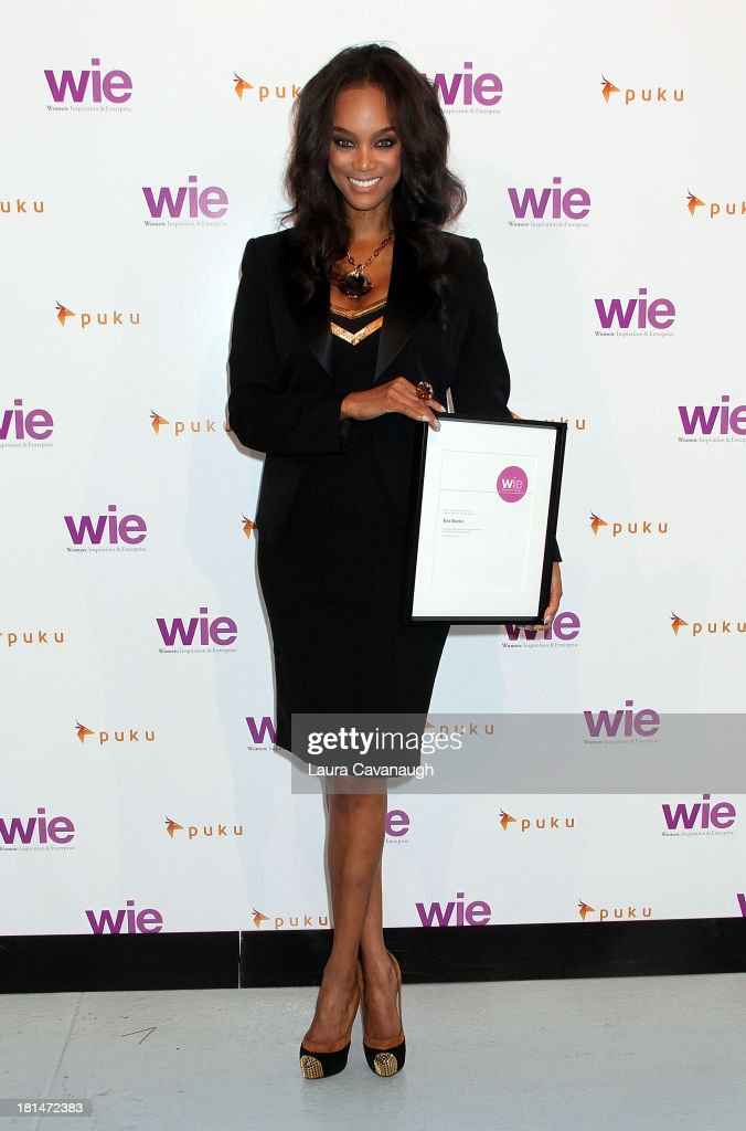 <a gi-track='captionPersonalityLinkClicked' href=/galleries/search?phrase=Tyra+Banks&family=editorial&specificpeople=202216 ng-click='$event.stopPropagation()'>Tyra Banks</a> attends day 2 of the 4th Annual WIE Symposium at Center 548 on September 21, 2013 in New York City.