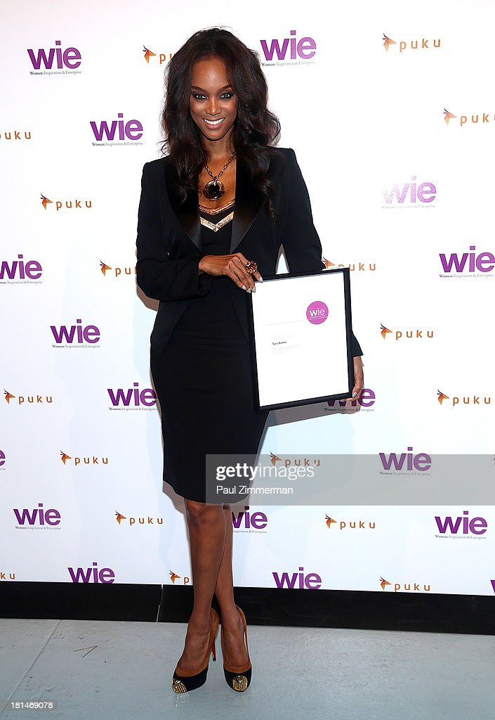 <a gi-track='captionPersonalityLinkClicked' href=/galleries/search?phrase=Tyra+Banks&family=editorial&specificpeople=202216 ng-click='$event.stopPropagation()'>Tyra Banks</a> attends the 4th Annual WIE Symposium at Center 548 on September 21, 2013 in New York City.