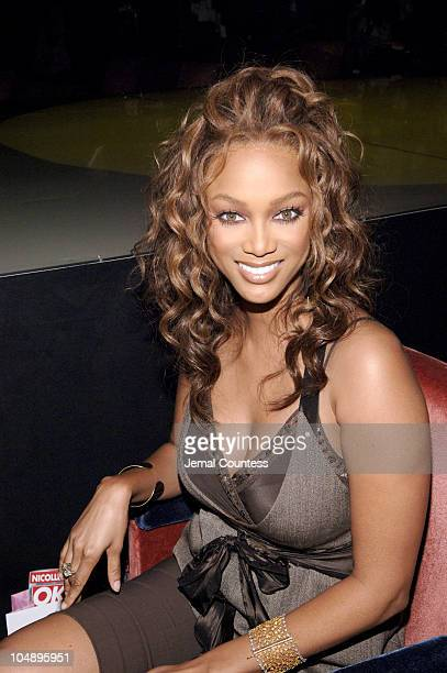 Tyra Banks during Olympus Fashion Week Spring 2006 Baby Phat Front Row and Backstage at Radio City Music Hall in New York City New York United States