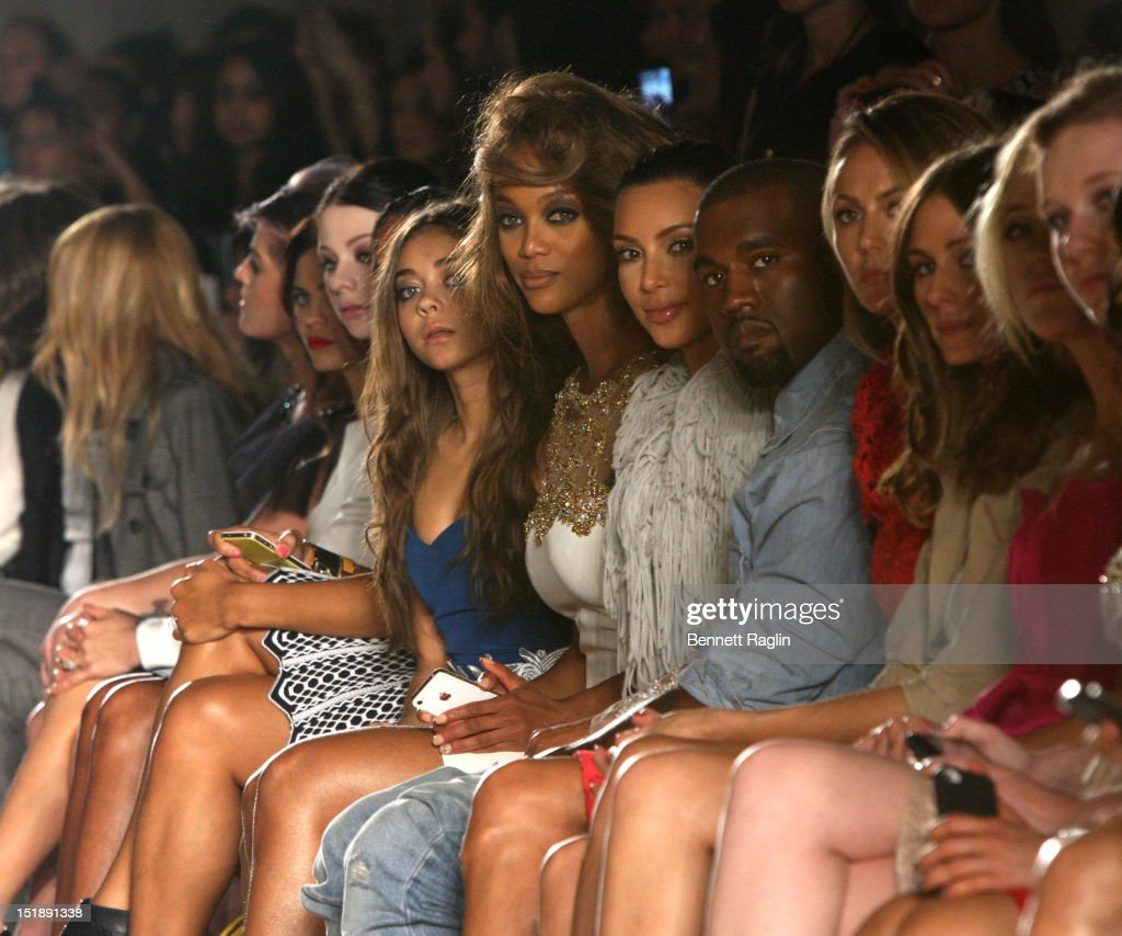 <a gi-track='captionPersonalityLinkClicked' href=/galleries/search?phrase=Tyra+Banks&family=editorial&specificpeople=202216 ng-click='$event.stopPropagation()'>Tyra Banks</a>, <a gi-track='captionPersonalityLinkClicked' href=/galleries/search?phrase=Kim+Kardashian&family=editorial&specificpeople=753387 ng-click='$event.stopPropagation()'>Kim Kardashian</a> and <a gi-track='captionPersonalityLinkClicked' href=/galleries/search?phrase=Kanye+West+-+Musician&family=editorial&specificpeople=201803 ng-click='$event.stopPropagation()'>Kanye West</a> attend the Marchesa show during Spring 2013 Mercedes-Benz Fashion Week at Grand Central Terminal on September 12, 2012 in New York City.