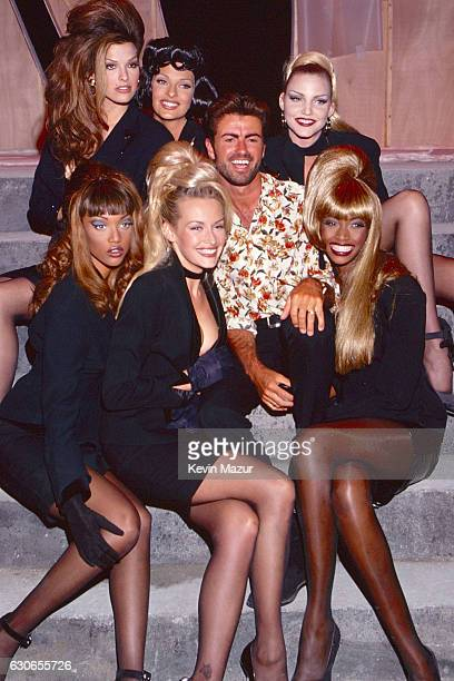 Tyra Banks Linda Evangelista George Michael and Eva Herzigova Beverly Peele pose during the 'Too Funky' video shoot circa 1992 in Paris France