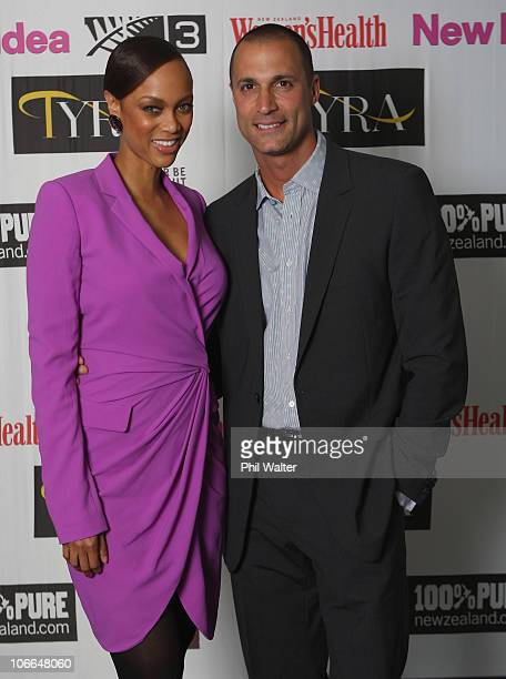 Tyra Banks poses with photographer Nigel Barker during the Tyra Banks Global BIO Summit at The Wharf on December 16 2009 in Auckland New Zealand